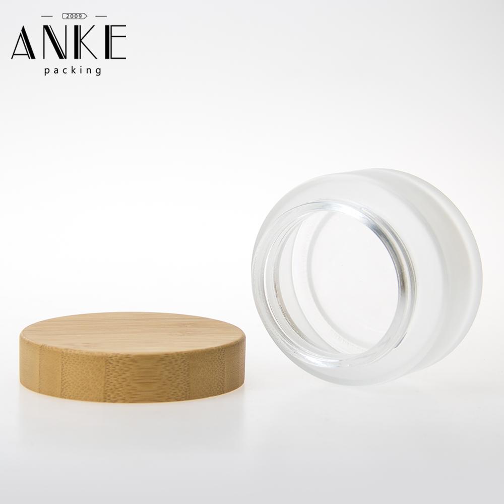 बांस की सामान्य टोपी के साथ 100 ग्राम फ्रॉस्टेड ग्लास क्रीम जार
